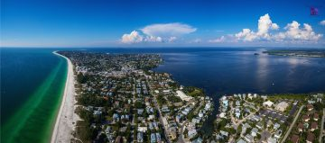 Ariel view of beach and houses on gulf of mexico in Anna Maria Island in Manatee County Florida