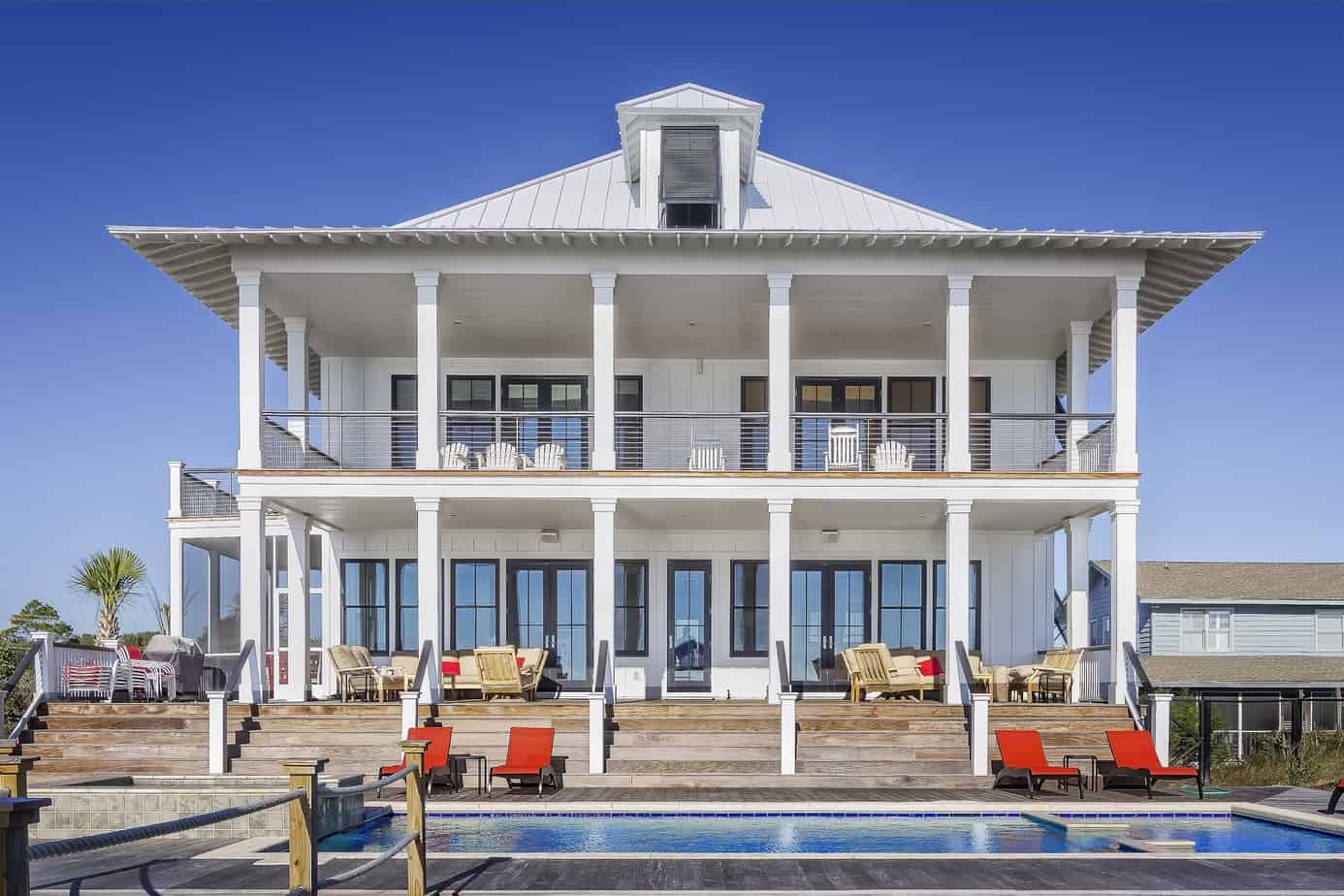 Largo Two story beach house with pool, double porch, and tin roof