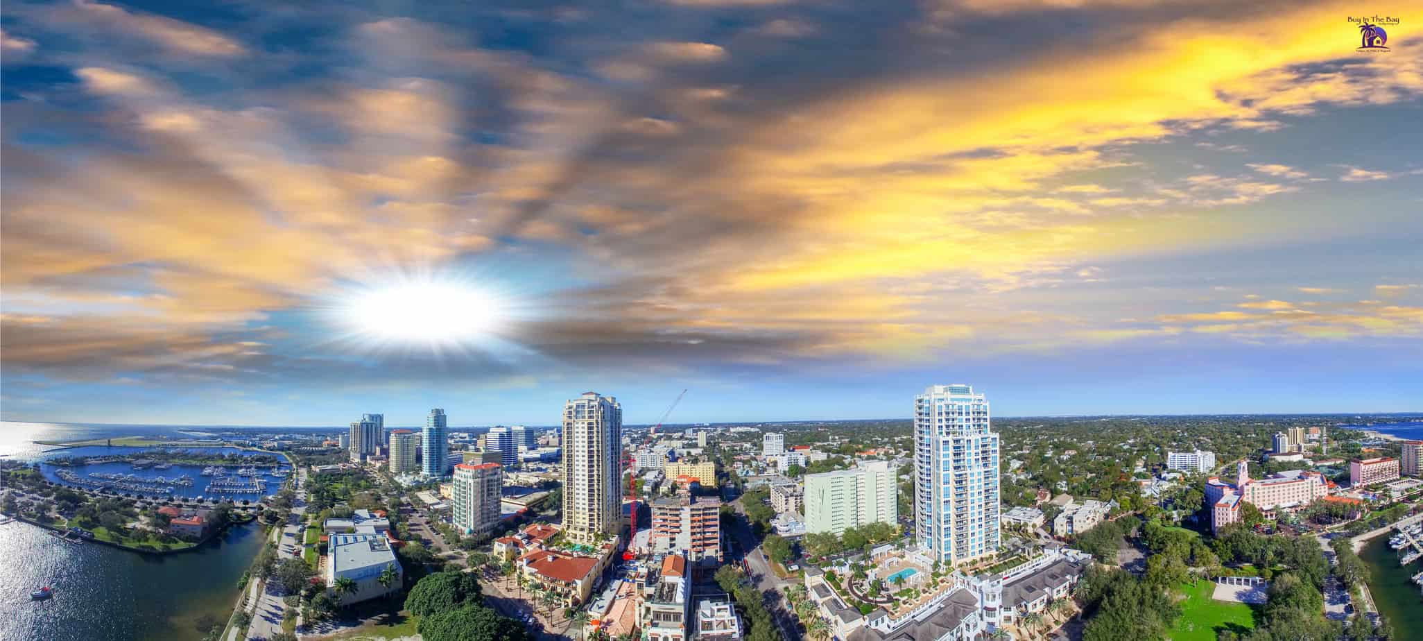 ariel view of the sunset over St. Pete in Pinellas County Florida with water and buildings