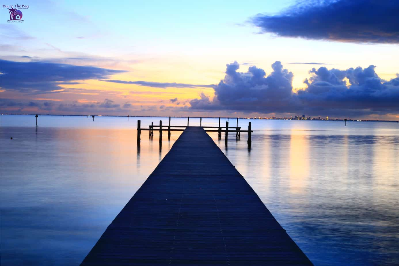 Sunset at Little Harbor in Ruskin FL with dock on water