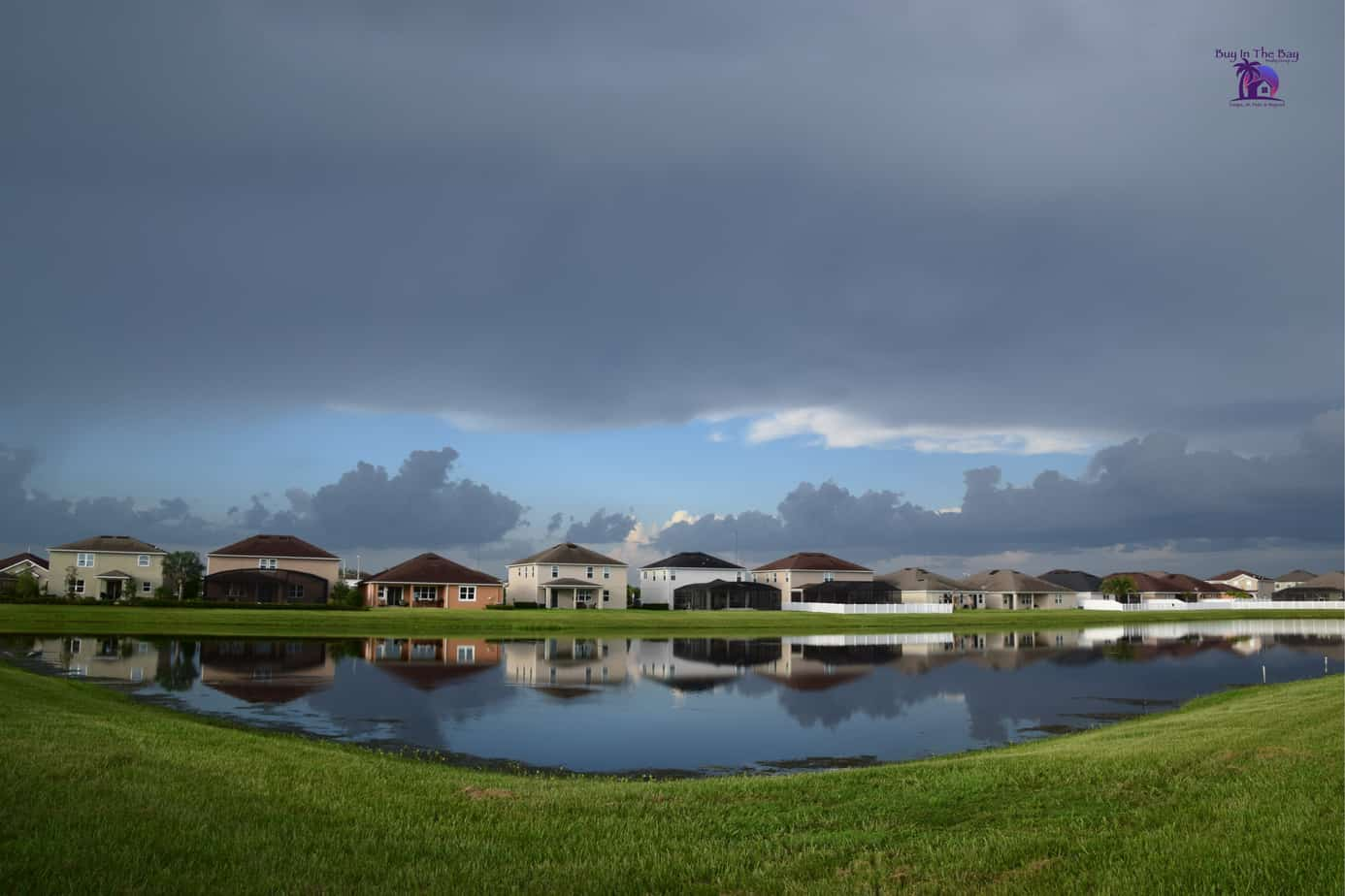 multi colored homes along a lake in Riverview Fl