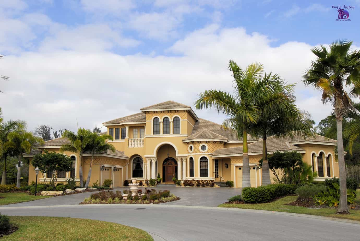 two story yellow executive style home that would be found in a neighborhood like lithia fish hawk ranch florida