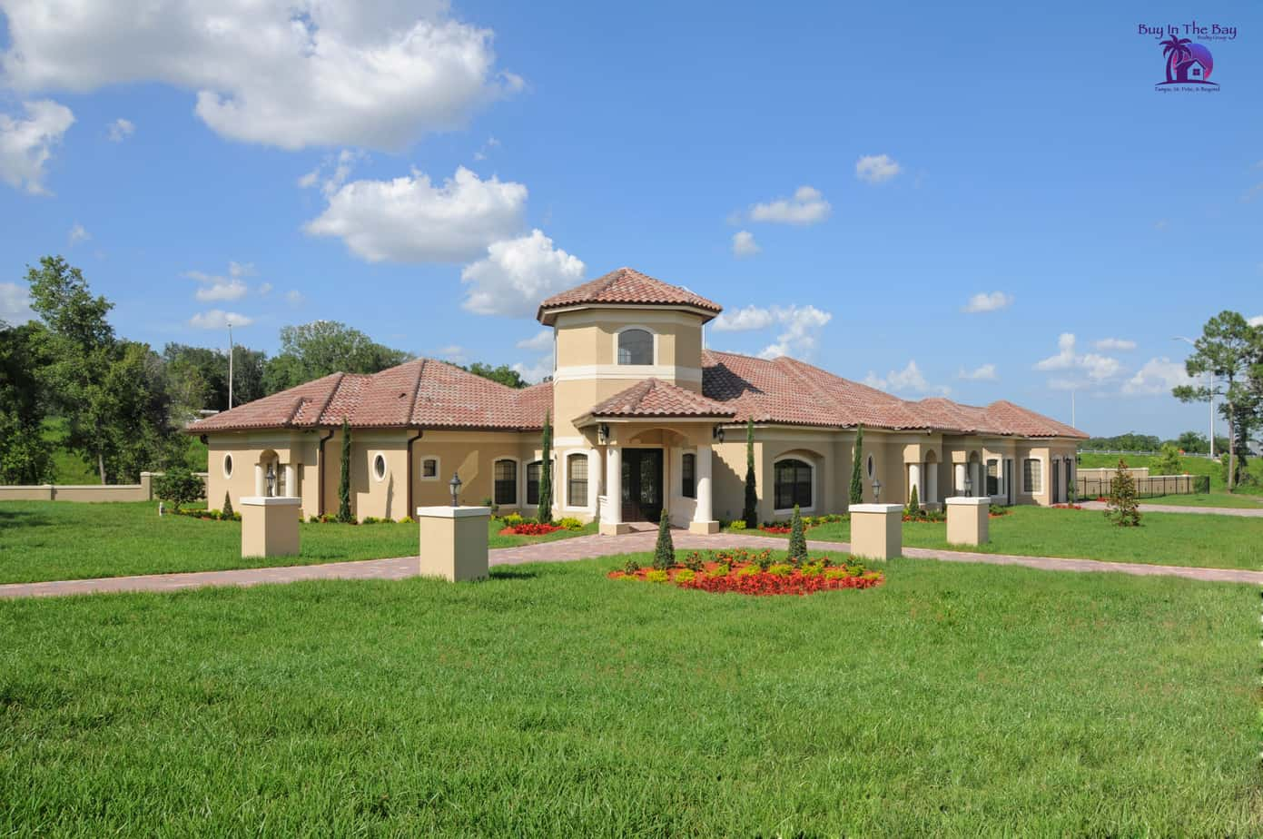 yellow home with tile barrel roof and land similar to a home found in Dover Florida