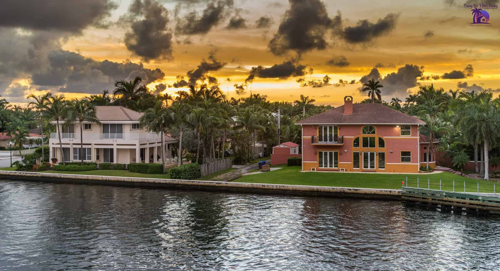 image of two waterfront homes with sunset in the background showing south tampa real estate