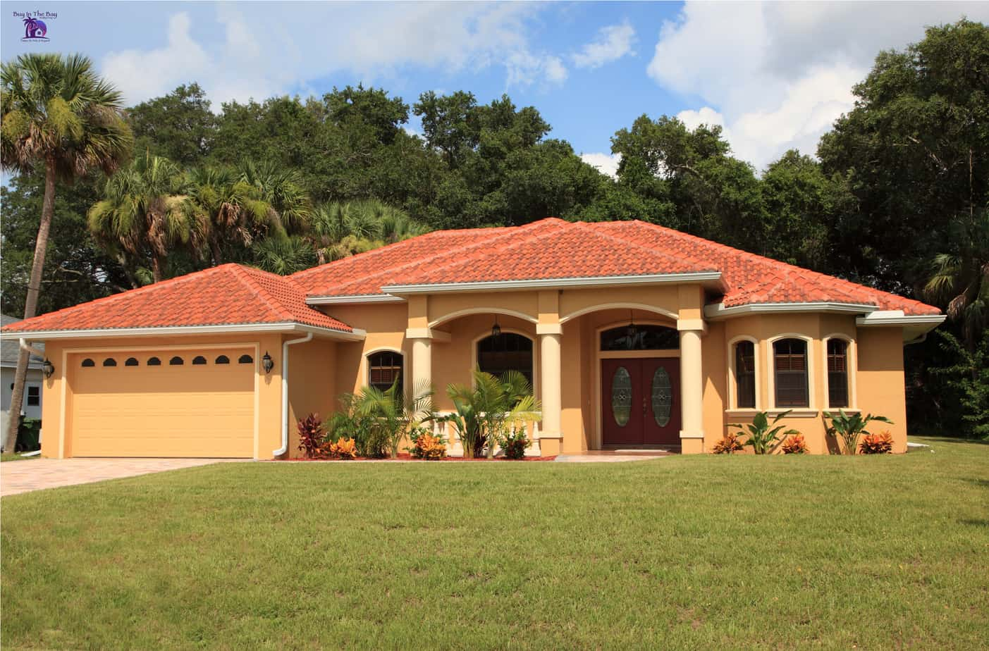 yellow one story home with red tile barrel roof similar to a home in Mango Florida