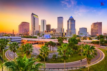 colorful skyline with sunset and tall building showing downtown tampa real estate for sale