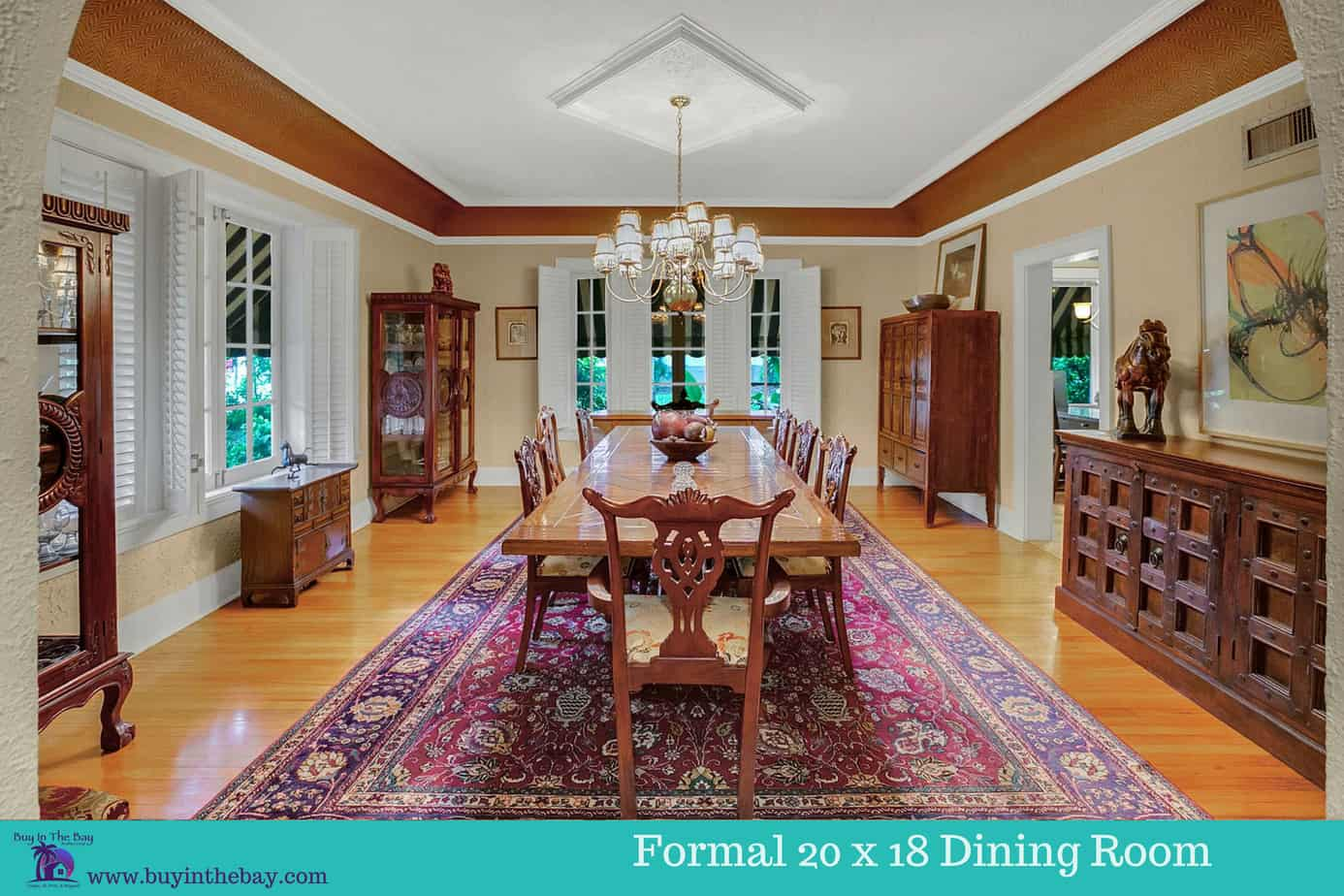 Formal 20 x 18 Dining Room With large dining table with that seats 10, wood floors, large window, and decorative light fixture for the home for sale at 4024 W Bay To Bay Blvd Tampa FL 33629. A perfect Example of a Historic Homes in Florida and a Tampa Bay Luxury Homes For sale.