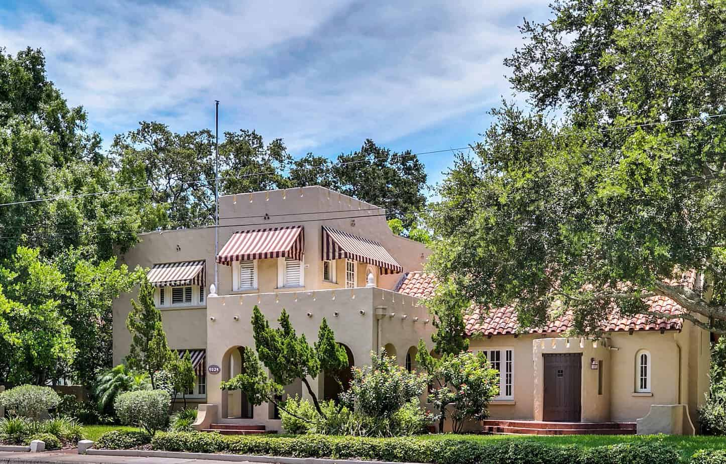 Exterior of luxury florida Mediterranean historic home with torrents, windows, and tile barrel roof for 4024 W Bay to Bay Blvd. Tampa FL 33629