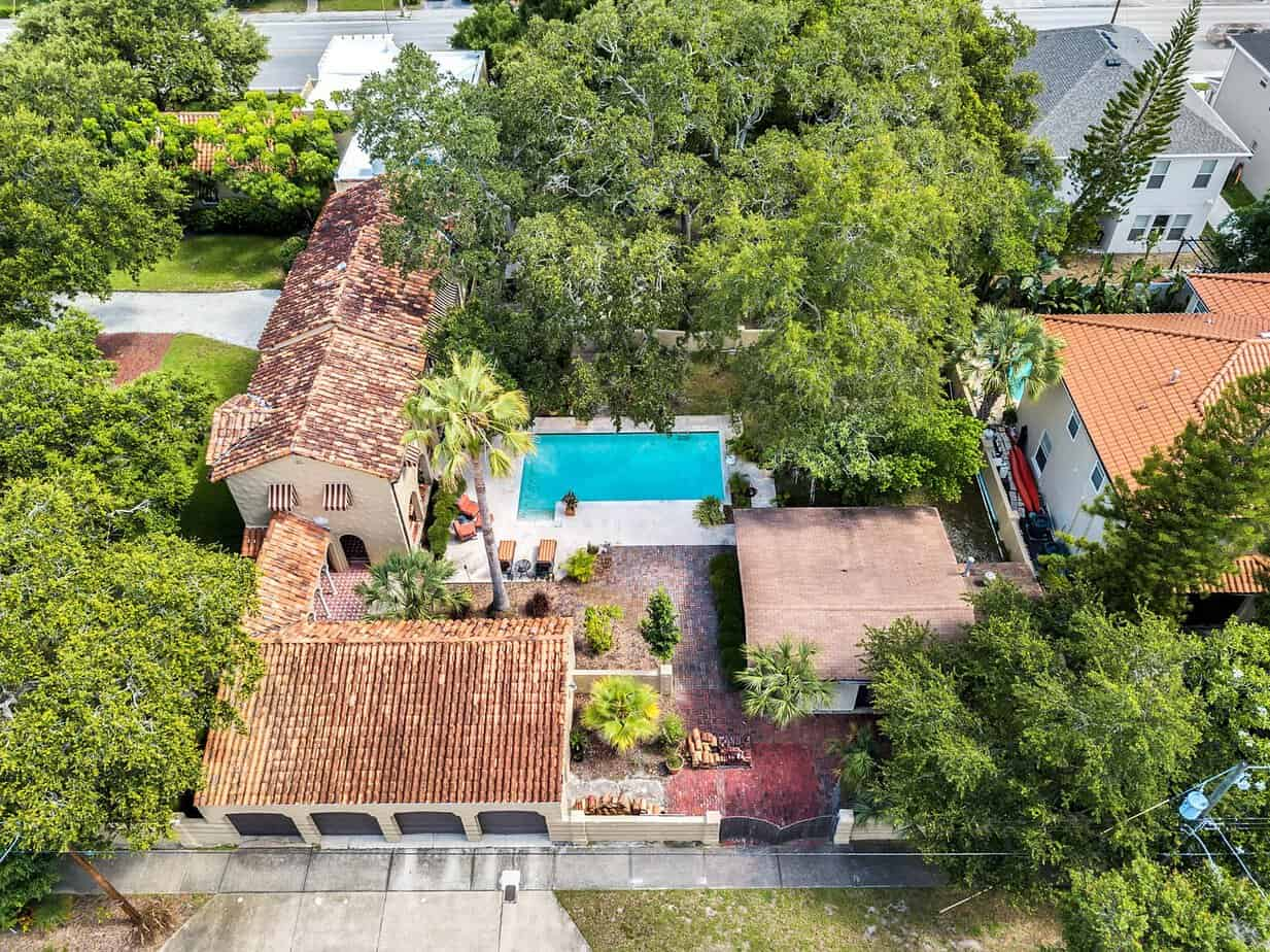 Ariel view of home for sale at 4024 W Bay to Bay showing roof, pool, trees, and city block