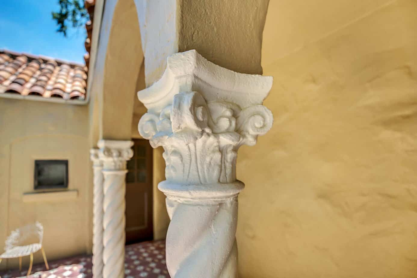 Up close picture of white spiral columns holding up one of the arches of the doorway at the home for sale at 4024 W Bay to Bay Tampa FL 33629