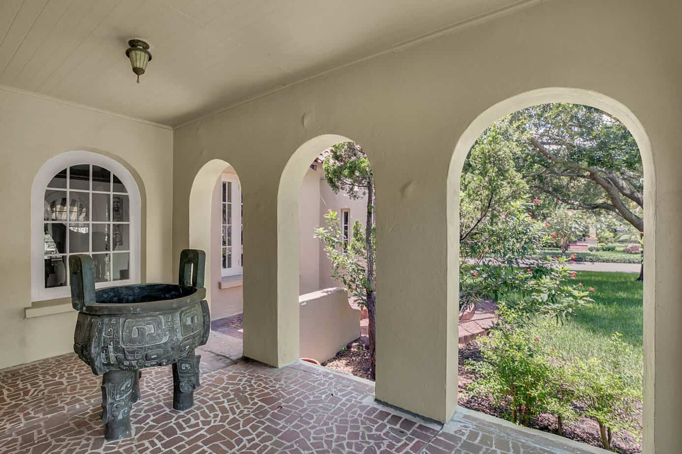 Front porch of home at 4024 W Bay to Bay Tampa FL 33629 with mosaic floors, 3 arched doorwats and an arched window