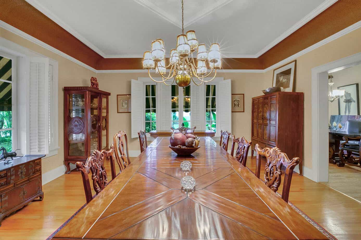 Formal 20 x 18 Dining Room With large dining table with that seats 10, wood floors, two large window, and decorative light fixture for the home for sale at 4024 W Bay To Bay Tampa FL 33629