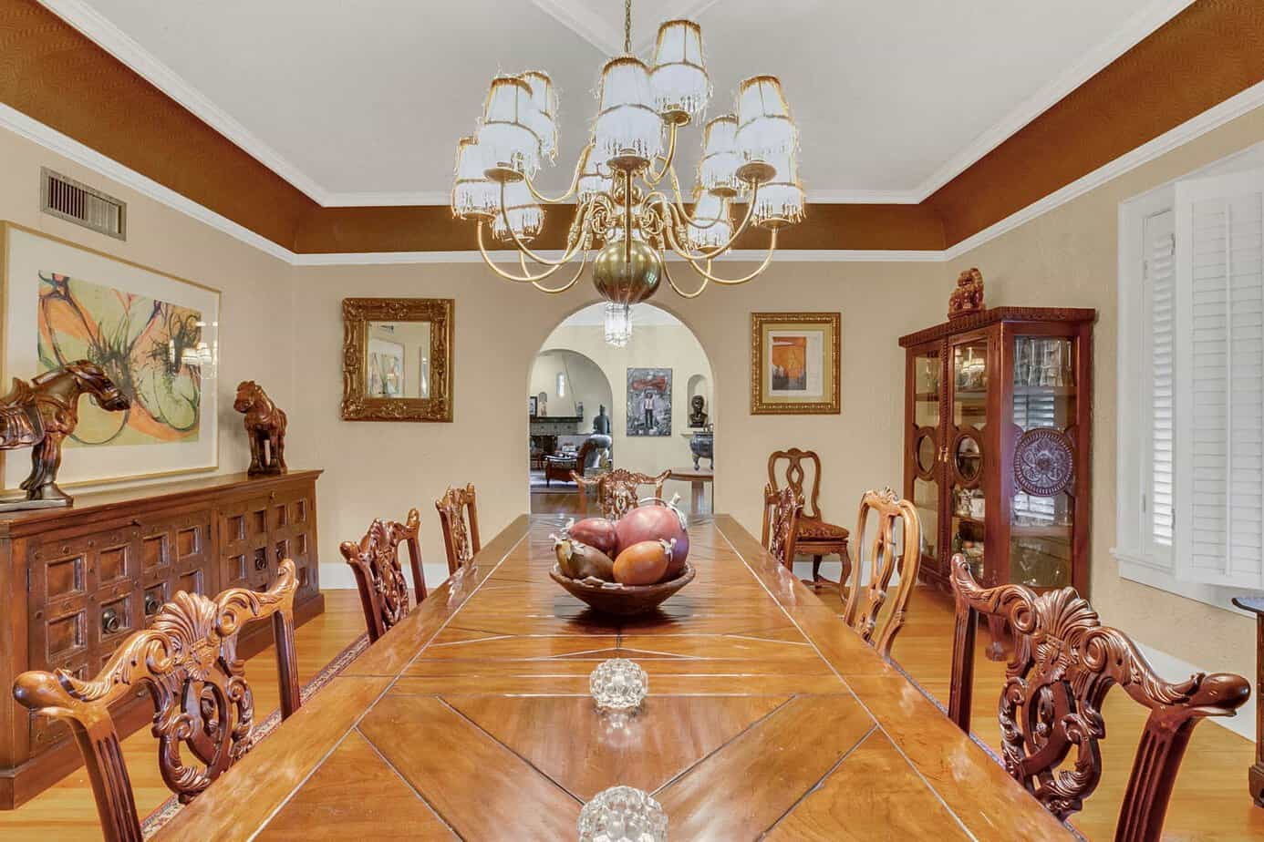 Formal 20 x 18 Dining Room With large dining table with that seats 10, wood floors, large window, and decorative light fixture for the home for sale at 4024 W Bay To Bay Tampa FL 33629