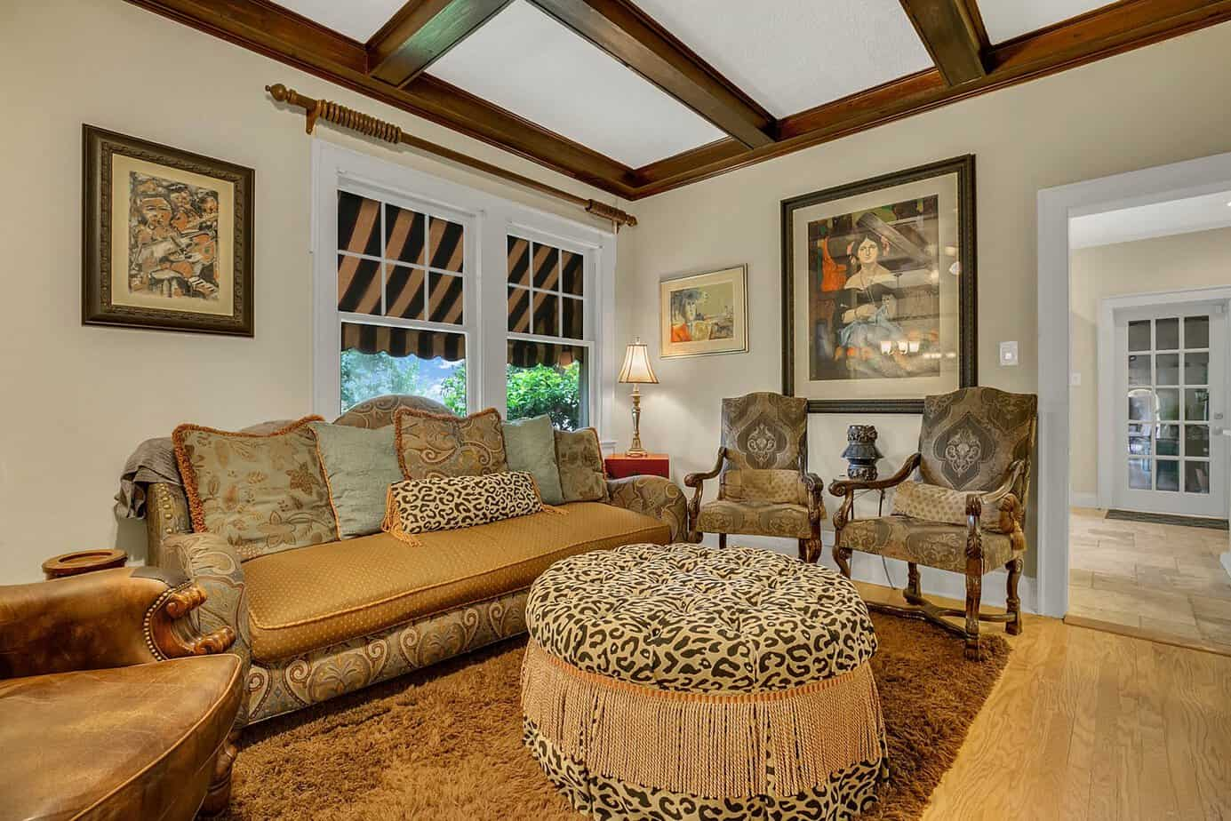 Picture of the cozy family room with couch, two chairs, wood floors, rug, beamed ceilings, for the home for sale at 4024 W Bay to Bay Tampa FL 33629