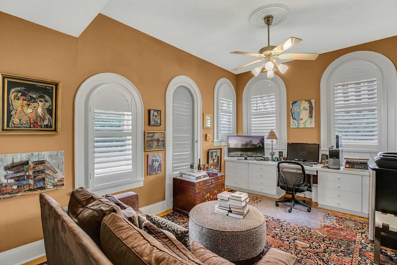 Upstairs office with orange walls, 5 arched windows, and wood floors for sale at 4024 W Bay to Bay Tampa FL 33629