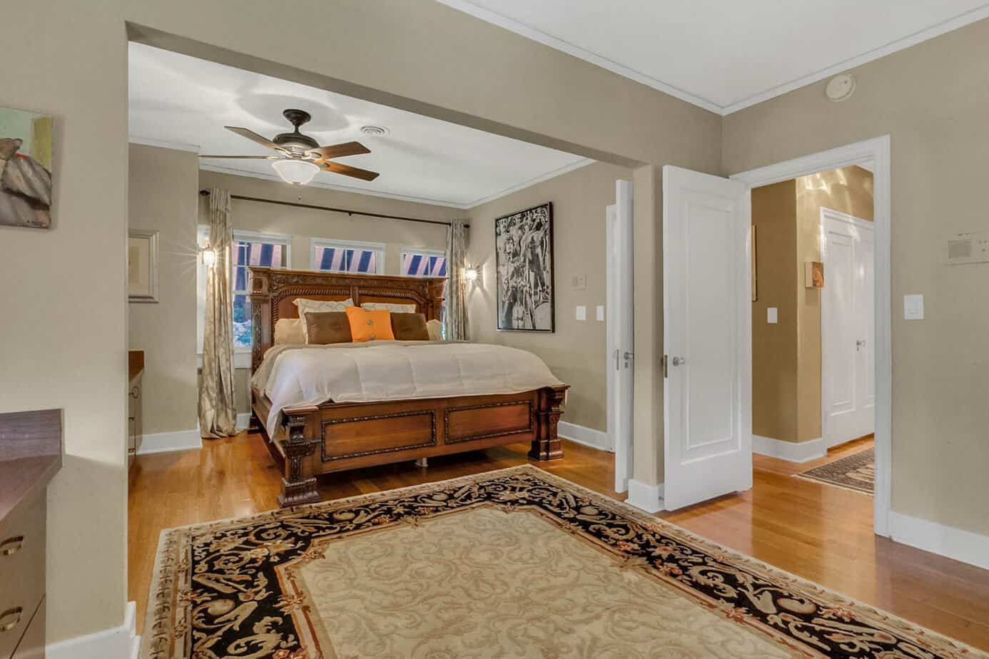 Picture of one of the dual master bedrooms with wood floors, Bed, ceiling fan, and decorative rug for the historic south tampa estate home for sale at 4024 W Bay To Bay Blvd. Tampa FL 33629