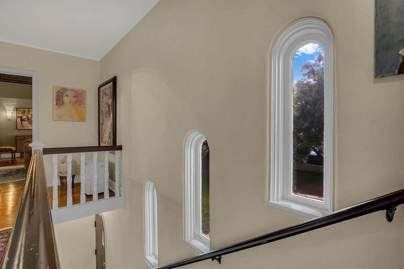 Picture of back staircase of 4024 W Bay to Bay Tampa FL 33629 with arched windows and artwork