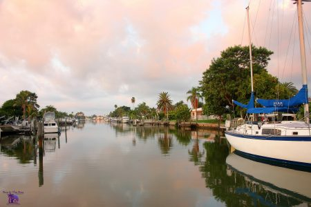 Image showing multiple Docked boats on the water in Boca Ciega Bay Madeira Beach Florida in the zip code of 33708 with a nice sunset in th ebackground