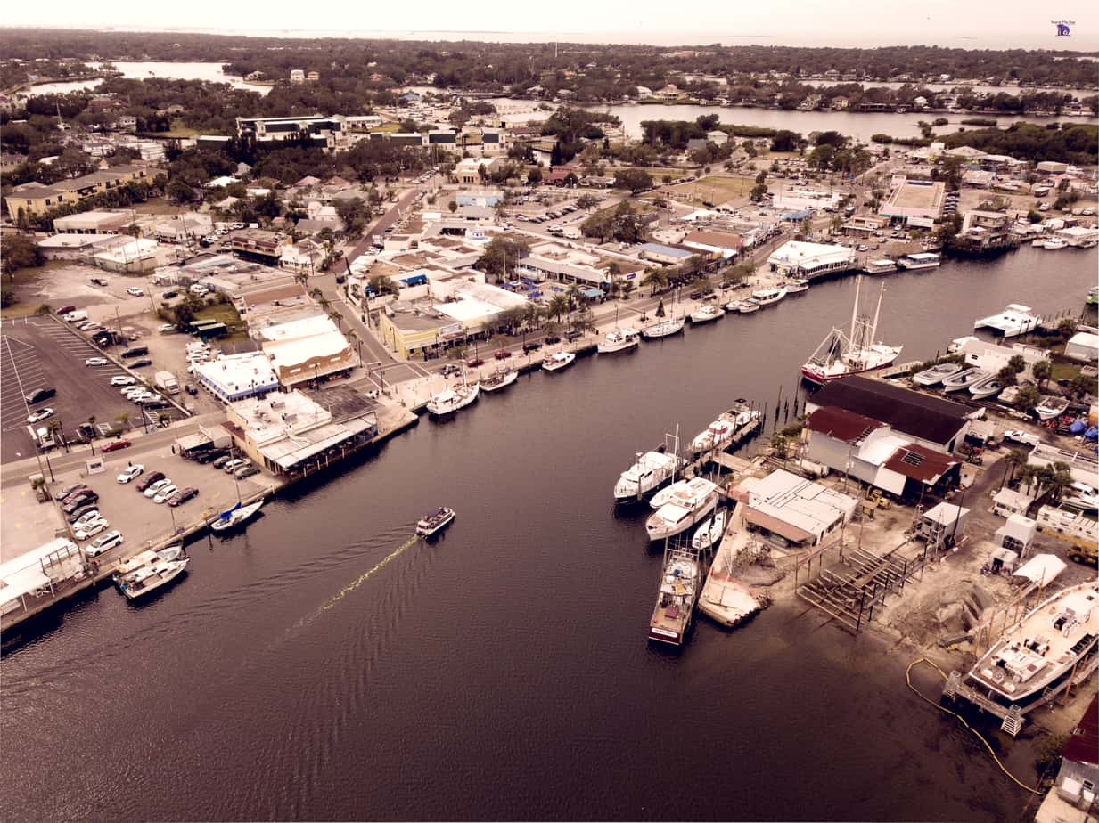 Picture of Downtown Tarpon Springs Sponge Docks in florida with Ariel view of water, boats, and businesses