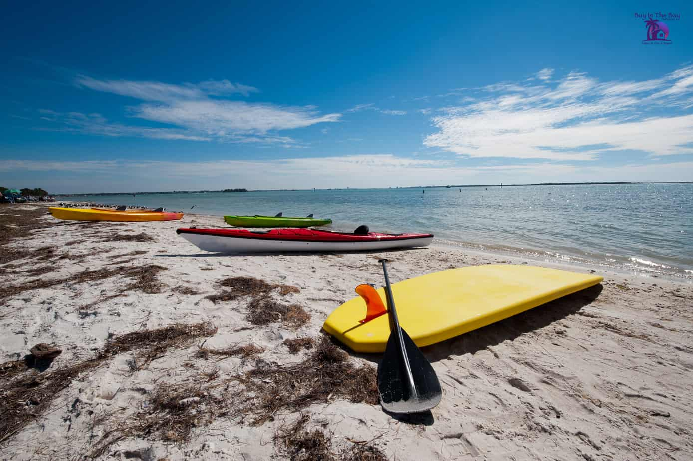 Picture of Honeymoon Island State Park in Palm Harbor Florida with the beach, water, and three kayaks