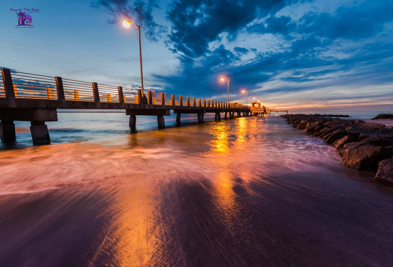 Fishing pier with beautiful sunset over multicolored water for the showcase image showing Tierra Verde FL real estate for 33716 showing homes for sale 33716