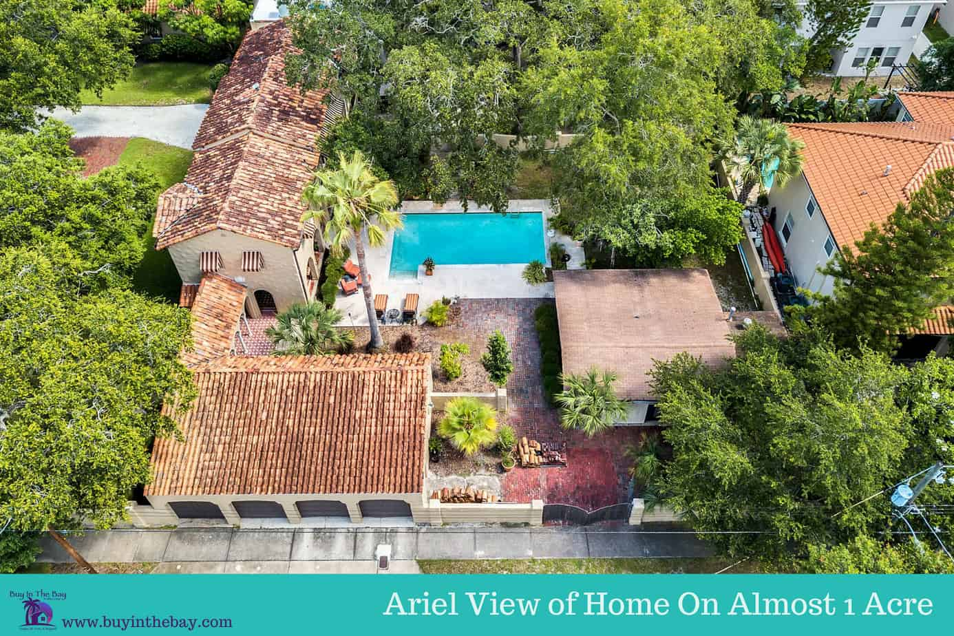 home for sale at 4024 W Bay to Bay Blvd showing roof, pool, trees, and city block. A perfect Example of a Historic Homes in Florida and a Tampa Bay Luxury Homes For sale.