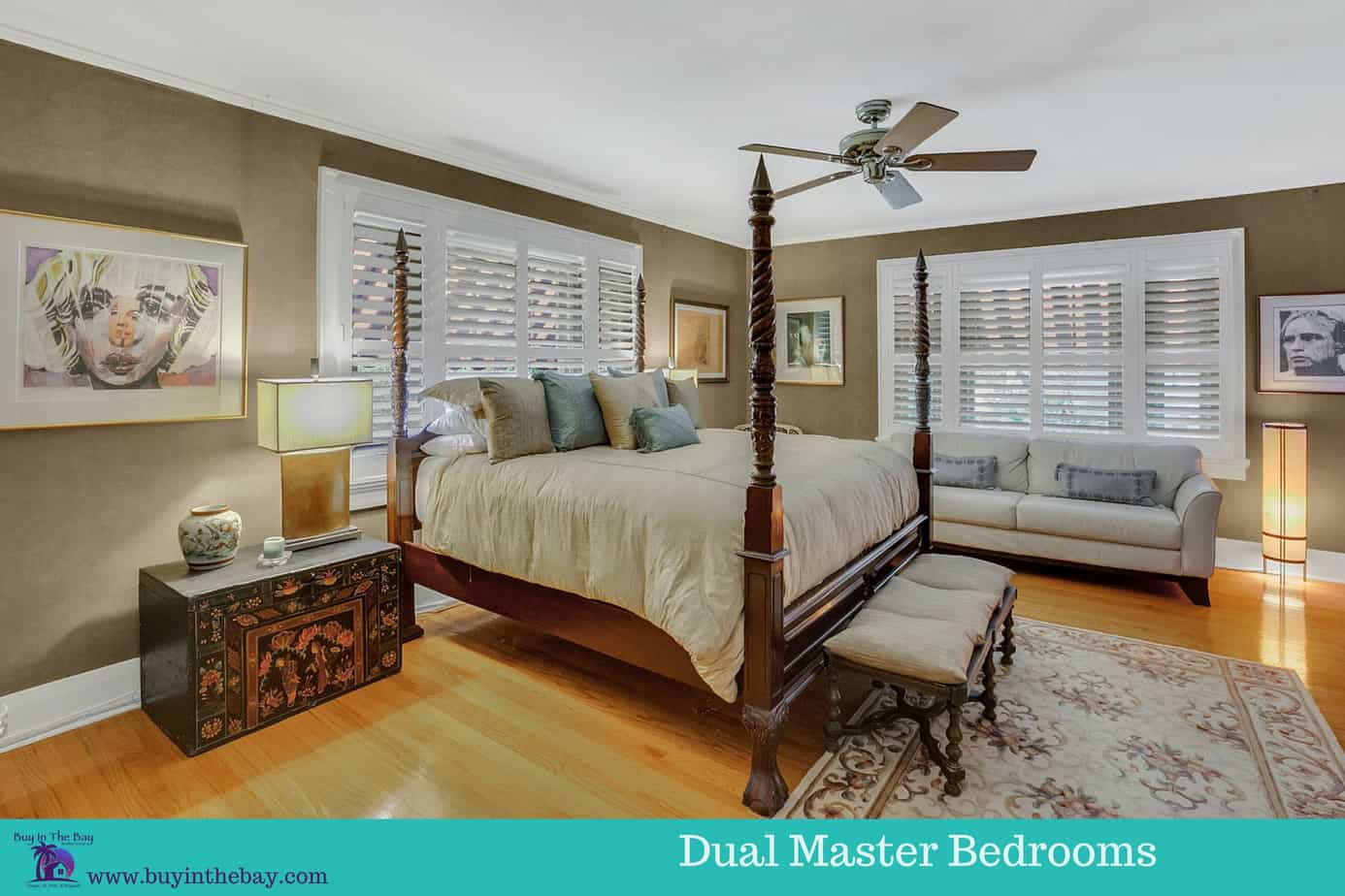 Image of master bedroom with two windows, king size bed, wood floors, and a ceiling fan for the home at 4024 W Bay to Bay Boulevard Tampa FL 33629 a great example of a Historic Homes in Florida and a Tampa Bay Luxury Homes For sale.