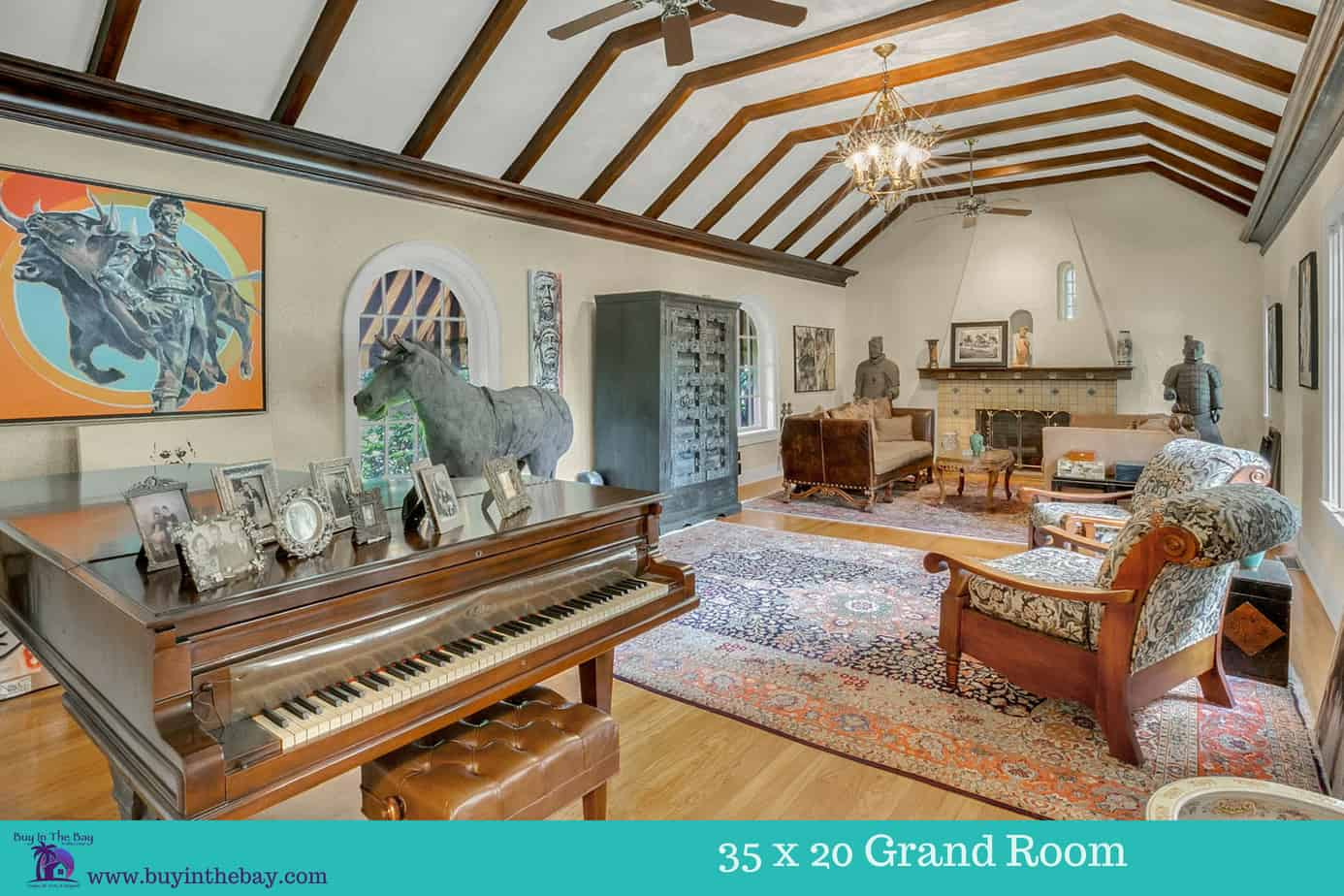 Picture of a Stately 35 x 20 Wood Beamed Ceiling Living room in a home for sale in South Tampa Florida. A perfect Example of a Historic Homes in Florida and a Tampa Bay Luxury Homes For sale.