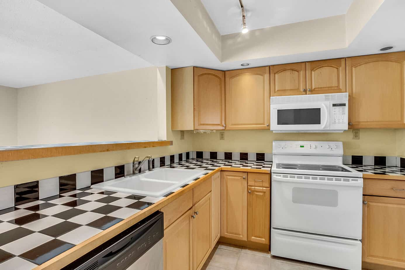 kitchen at 408 S Arrawana Ave Tampa FL 33609 with tan cabinets and checkered tile countertops