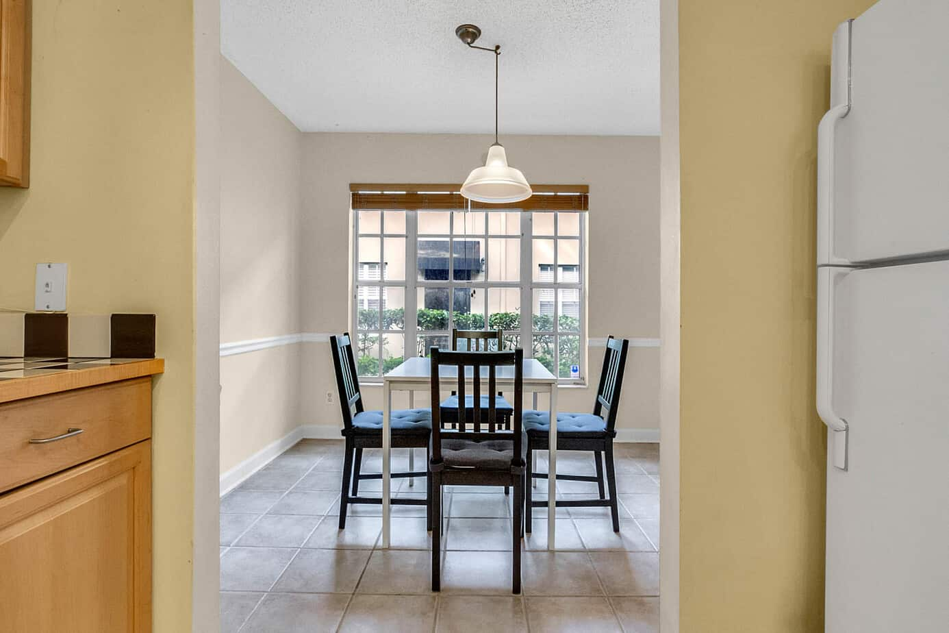 dining area of 408 S Arrawana Ave Tampa FL 33609 with brown chairs and white table