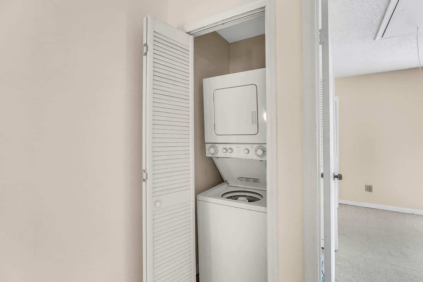 image of a close with a white stackable washer/dryer in 408 S Arrawana Ave Tampa FL 33609