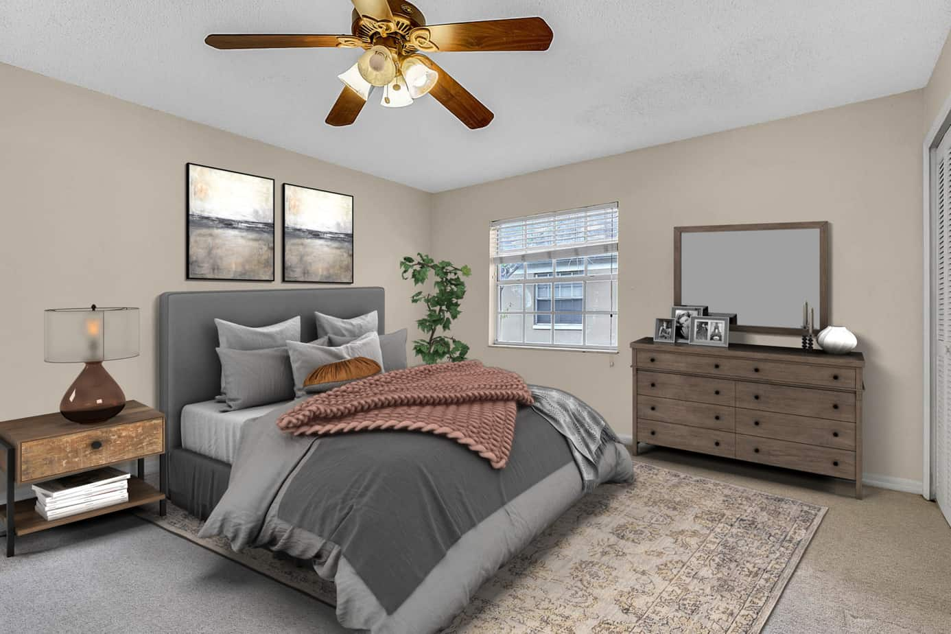 Image of bedroom of 408 S Arrawana Ave #C3 Tampa FL 33609 with gray bed, oriental rug, and dresser